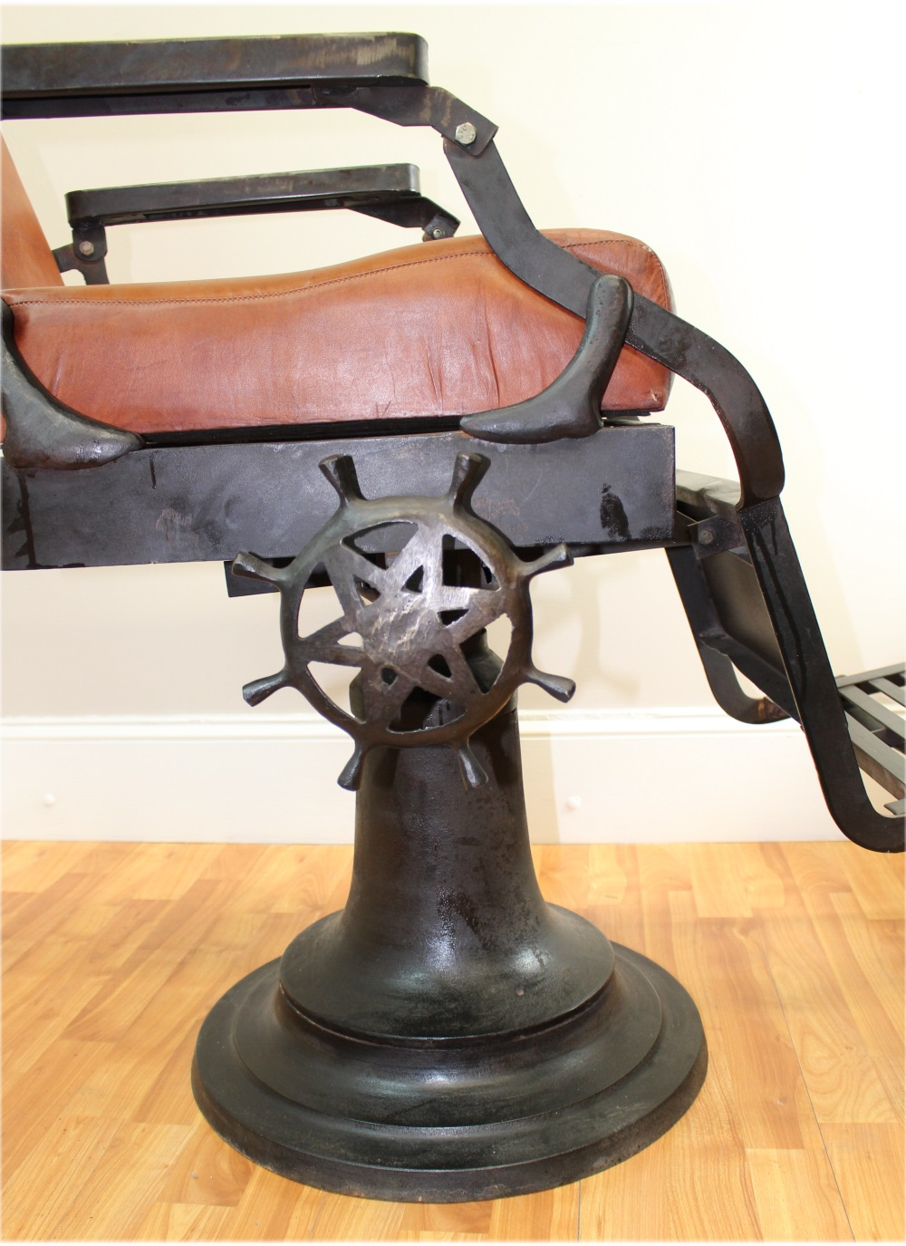 Antique Cast Iron Chairs : Barber chair with leather seat cushions cast iron base