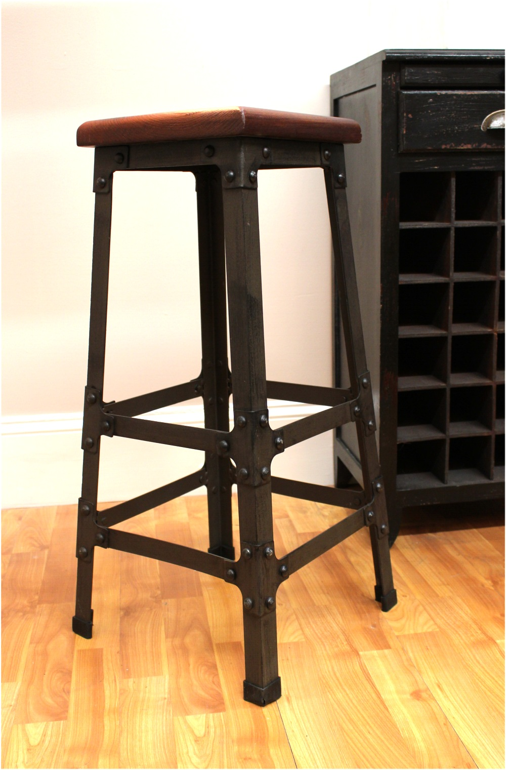 Bar Stool with Wooden Seat amp Riveted Iron Legs for Home  : 4f2ca4e6 b7a5 5701 8c2c bd2b2de1d9e0 from thekingsbay.com size 1000 x 1521 jpeg 274kB