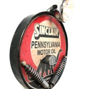 Sinclair motor oil company Dino dinosaur motorcycle headlight wall sign antique style
