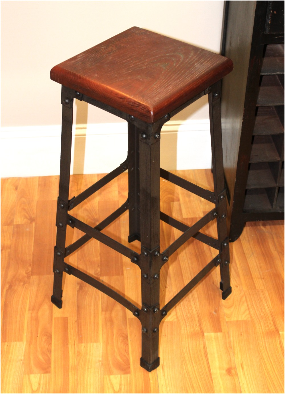 Bar stool with wooden seat riveted iron legs for home