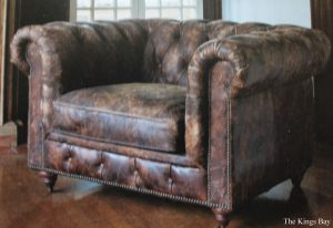 Distressed Leather Churchill Club Chair With Tacs and Wood Bung Feet